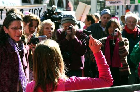 Photo: Medea Benjamin, national co-founder of Code Pink, speaks to a crowd of onlookers at a mock debate yesterday outside of the Marine recruitment center on Shattuck Avenue.