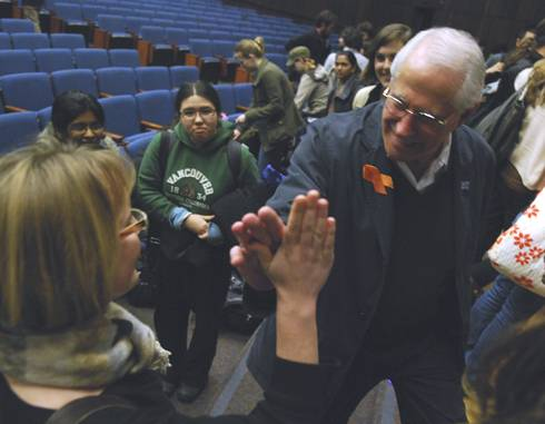 Photo: Democratic candidate Mike Gravel gives freshman Hannah Jewell a high five after speaking to the Political Science 179 class Wednesday afternoon in Wheeler Auditorium.