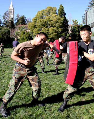Photo: ROTC students Don Reyes (CCSF) and senior Edward Yang participate in training exercises for military service. ROTC members in Berkeley face unique challenges.