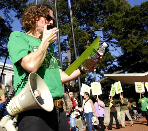 Photo: Kathryn Lybarger protests against the proposal. Lybarger is the union's bargaining representative and a lead gardener for the campus.