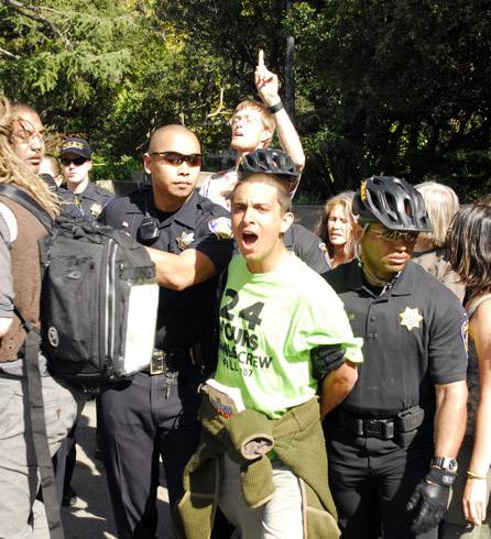 Photo: Jason Ahmadi, a UC Berkeley alumnus, is arrested at a campus protest targeting the UC Board of Regents. Ahmadi said he made a banner used in the protest.