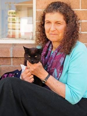 Photo: Arlene Blum, a visiting scholar and chemist studying toxin levels in animals, holds her cat Midnight, who has been diagnosed with hyperthyroidism due to toxin exposure.