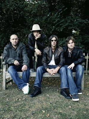 Photo: ALTOGETHER NOW. Simon Jones (second from left), bassist for the Verve, discussed the challenge of making music after the success of 'Urban Hymns.'