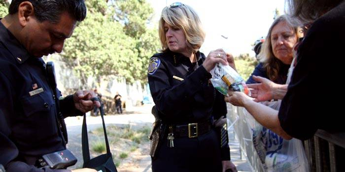 Photo: UCPD Police Chief Victoria Harrison (center) negotiates with members of Grandmothers for the Oaks over supplying the tree-sitters.