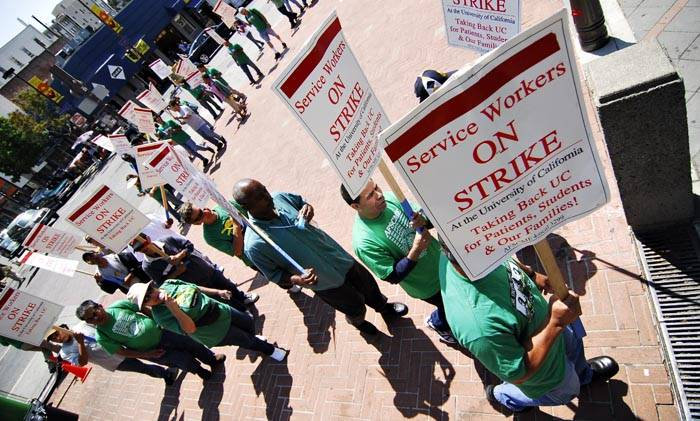 Photo: AFSCME Local 3299 strikers protest at the intersection of Bancroft Way and Telegraph Avenue, blocking traffic earlier in the day.