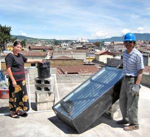Photo: Quetzaltenango, Guatemala residents stand on the roof where a new solar water heater, designed by a UC Berkeley team to be used by low-income households, was installed.