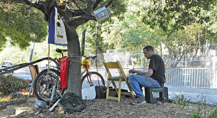 Photo: DJ Stump, who runs the 104.1 FM Tree-Berkeley radio station, camps out on the Piedmont Avenue median on Sunday afternoon.