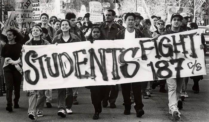 Photo: Protesting students march down Bancroft Way in a rally against Proposition 187, which sought to crack down on illegal immigration. Activism has been a tradition at UC Berkeley for the past several decades.