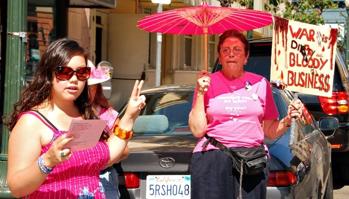 Photo: Code Pink supporters celebrate the one year anniversary of their protest against the marine recruitment center.
