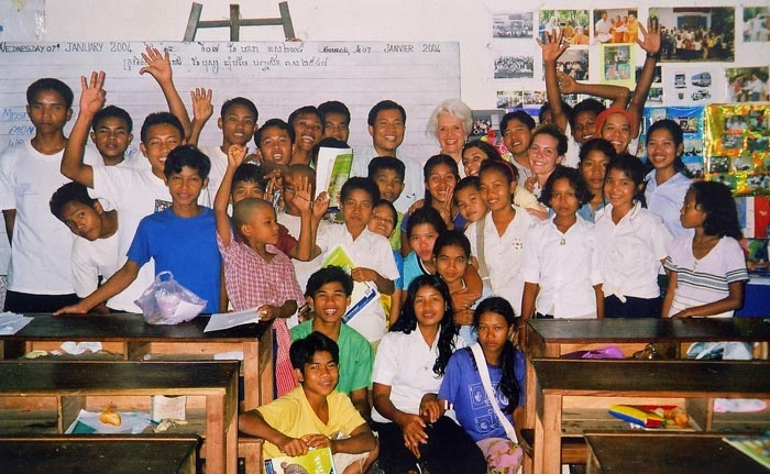 Photo: Professor Marian Diamond, center, poses with orphaned students at the Wat Racha Sin Khon monastery. Diamond travels to Cambodia to teach the children every winter.