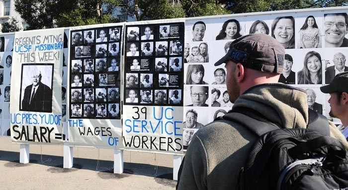 Photo: Banners were hung on the portrait wall outside of Dwinelle Hall calling for increased wages for UC workers and democratization of the board of regents.