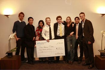 Photo: Chris Anderson, standing center with the seven other scholarship finalists, was one of the group of three UC Berkeley graduate students awarded the Meltwater Scholarship.