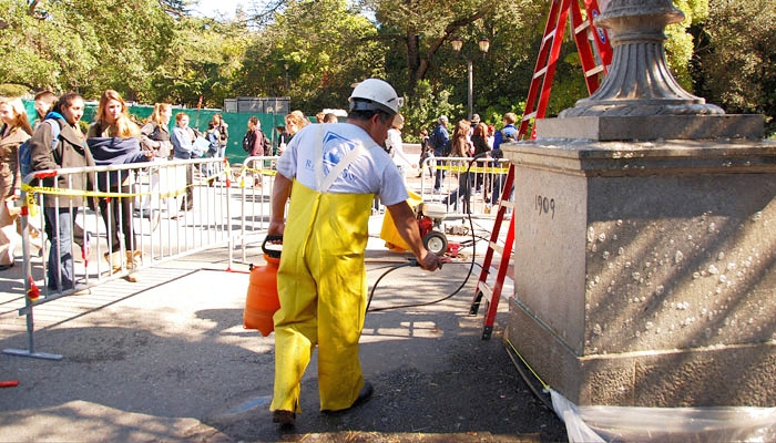 Photo: A restoration worker cleans the area of Sather Gate Bridge that until recently exhibited a popular imprint of Jimi Hendrix.