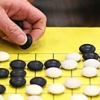 Photo: Enthusiasts and newcomers focus intently on a game of Go at Berkeley Games on Shattuck.