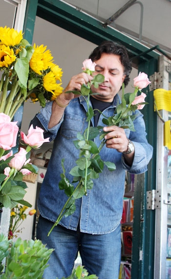 Photo: Ashby Flowers co-owner Iraj Misaghi arranges roses at his which is located in thee Whole Foods parking lot. After pressure from the community, Whole Foods decided to reconsider renewing the flower shop's lease.