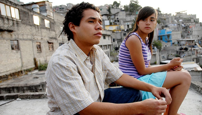 Photo: The thinkers. Guillermo Villegas (as Orlando) and Paulina Gaitan (as Sayra) in a scene from 'Sin Nombre,' a Spanish-language, genre-bending film by director Cary Joji Fukunaga.