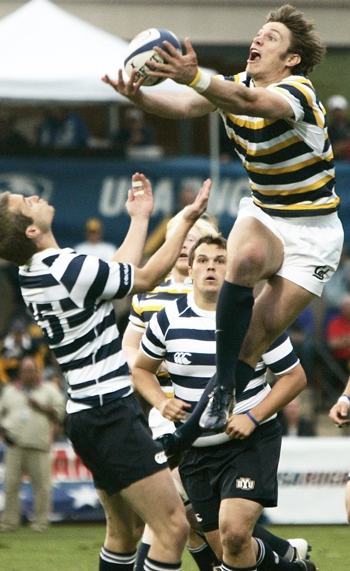 Photo: Junior wing Blaine Scully leaps above a BYU rugger for a loose ball. A sixth consecutive championship landed just out of Cal's reach, though, as the Cougars won their first-ever title.