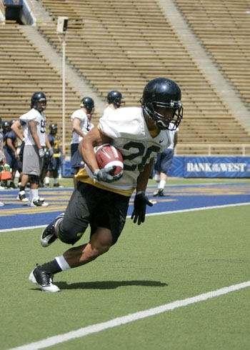 Photo: <b>Freshman Isi Sofele</b> is the shortest player on this year's roster at 5-foot-7, but he is using his speed to find his niche on the field.