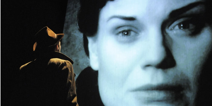 Photo: <b>Screen time.</b> Alec (Milo Twomey) gazes at an image of Laura (Hannah Yelland) in ACT's production of Noel Coward's 'Brief Encounter.'