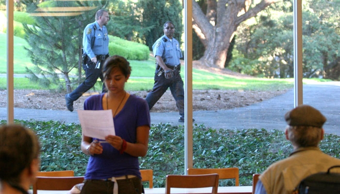 Photo: Police stand outside a teach-in held in Tolman Hall's Education and Psychology Library.
