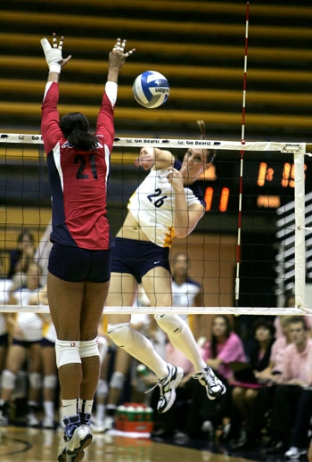 Photo: <b>Hana Cutura</b> (26) follows through on a spike during a victory against Arizona on Friday, when the outside hitter posted a career-high 31 kills. She finished the weekend with 52.