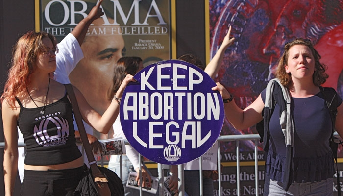 Photo: <b>A group of pro-choice students</b> rallied in front of a pro-life display on Sproul sponsored by the Berkeley Students for Life.