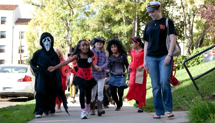 Photo: Rosa Parks Elementary School students participate Wednesday in the ninth annual Trick-or-Greek, a philanthropic event hosted by UC Berkeley fraternities and sororities in order to provide a safe trick-or-treating neighborhood for children.