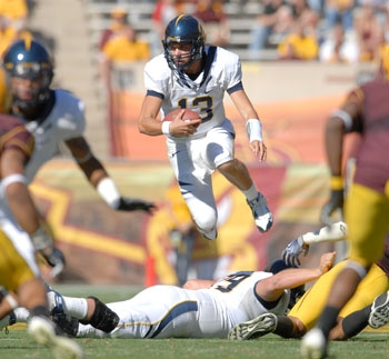 Photo: <b>Cal quarterback Kevin Riley</b> completed 27 of 44 passes for 351 yards and two touchdowns, and orchestrated an 11-play drive that set up Giorgio Tavecchio's game-winning field goal in Cal's 23-21 win over Arizona State.