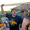 Photo: <b>Frankie Figueroa</b>, a 2006 Cal alum who majored in computer science, celebrates the Bears' victory with the small Cal contingent at Saturday's game.