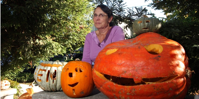 Photo: Dana MacDermott, along with her husband Bruce, hosts an annual Halloween party at the couple's Ashby Avenue home, where attendees carve creative designs into giant pumpkins.