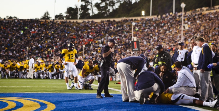 Photo: <b>Cal tailback Jahvid Best</b> is surrounded by team and medical personnel after his touchdown run in the second quarter on Saturday at Memorial Stadium. Best sustained a concussion.