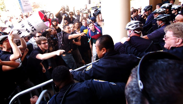 Photo: <b>Protesters and police</b> clash outside of the UC Board of Regents meeting held at UCLA. Fourteen people were arrested after disrupting the meeting, including 12 UC students.