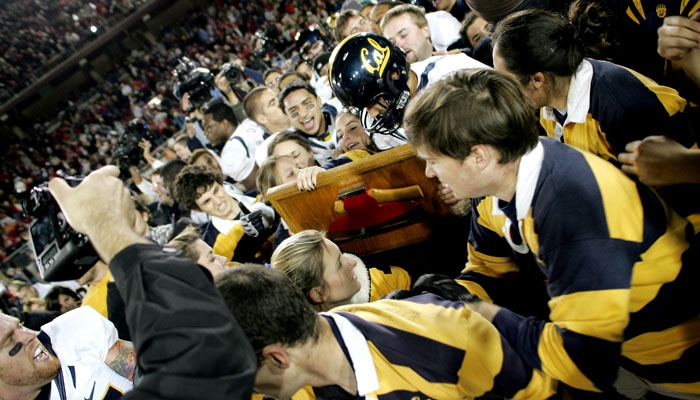 Photo: Players and fans celebrate on the field with the Axe after Cal defeated Stanford at Stanford Stadium in the 112th edition of the Big Game.