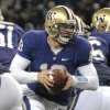 Photo: <b>Huskies quarterback Jake Locker</b> maneuvers in the backfield on Saturday at Husky Stadium. The junior had three passing touchdowns and two more on the ground.