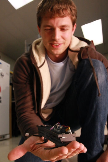 Photo: Paul Birkmeyer, the graduate student who designed the robots, shows his creation. Researchers are trying to add cameras and detectors that can locate people's breath.