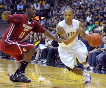 Photo: Point guard Jerome Randle drives the lane against Cougars guard Xavier Thames in the Bears' victory on Saturday at Haas Pavilion.