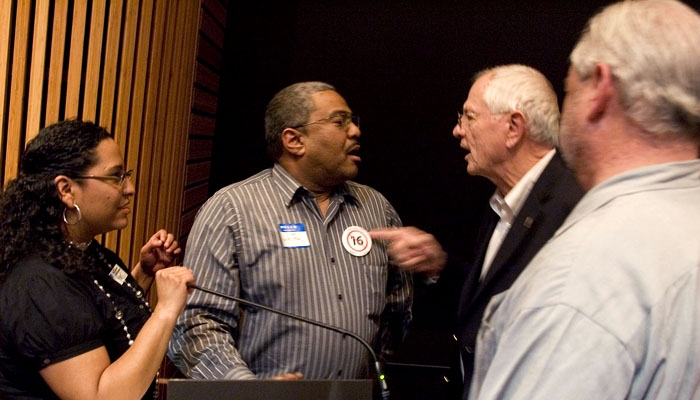 Photo: Berkeley Mayor Tom Bates pushed Mark Toney, an opponent of Proposition 16, away from the podium at a PG&E advisory meeting Feb. 18. Bates also opposes the proposition, but according to his chief of staff Julie Sinai, his actions were in response to the protesters'