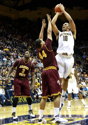 Photo: <b>Senior forward Jamal Boykin</b> shoots over Arizona State guard Jerren Shipp during the Bears' title-clinching win on Saturday at Haas Pavilion.