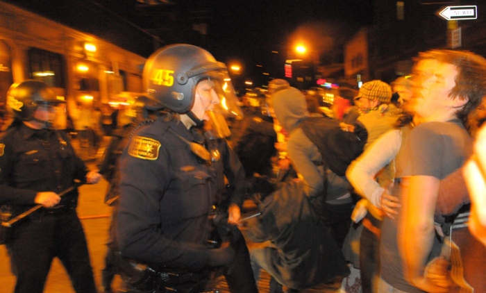 Photo: Berkeley police and UCPD clashed with rioters Friday. UCPD Chief Mitch Celaya said the department was reluctant to arrest many protesters because officers were outnumbered.