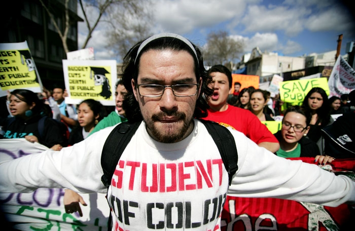 Photo: Ruben Canedo, a UC Berkeley junior, was among the group of over 1,000 people who marched to Downtown Oakland protesting in support of public education. The group would later join a rally of thousands more in San Francisco.