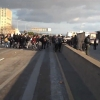 Photo: <b>Demonstrators</b> ran onto Interstate 980 last Thursday. Nearly 150 of them were booked, along with freshman Cameron Burns of The Daily Californian, who was filming the protest.