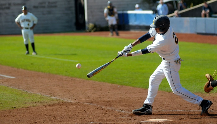 Photo: <b>Darrel Matthews</b>, Bears center fielder, was driven in by designated hitter Brian Guinn on a single up the middle for Cal's fifth run in the bottom of the seventh inning on Sunday.
