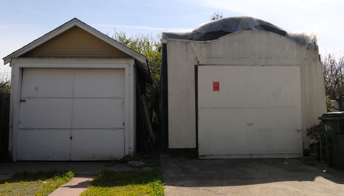 Photo: Ryan Lau, member of the city's Zoning Adjustment Board and aid to City Councilmember Darryl Moore, was cited Monday for construction work done on a garage on his property (pictured) without the proper permits.