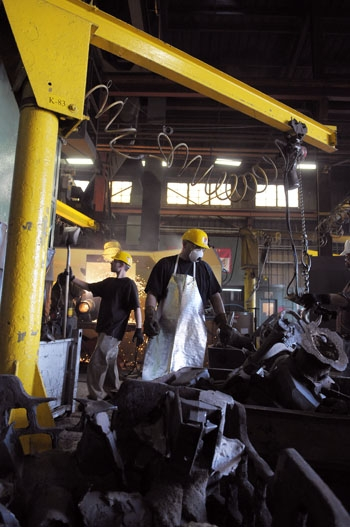 Photo: Employees at Pacific Steel and Casting in West Berkeley work on manufacturing steel products. Some of the city's manufacturing companies have reported recent job growth.