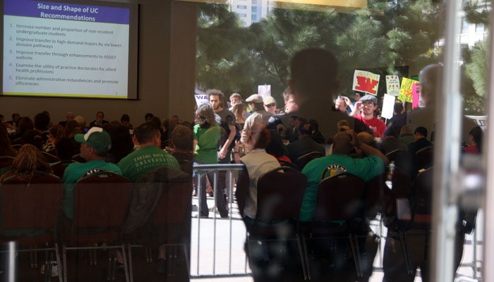 Photo: <b>Protesters</b> watched as members of the Commission on the Future presented recommendations to improve the UC system last Tuesday.