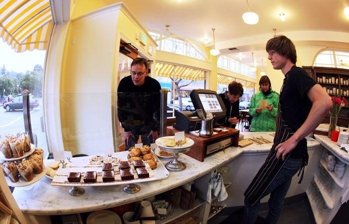 Photo: Scott Hansen (left) inspects cakes as David Morawski looks on at the Elmwood Cafe, a restaurant adhering to the Slow Food philosophy.