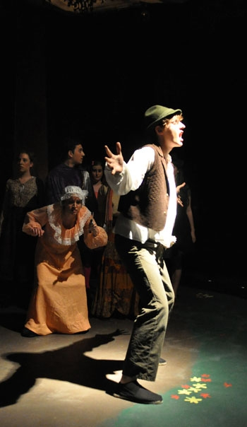 Photo: <b>Into the wild.</b> Though they have to cope with a restricting venue, BareStage's production of Stephen Sondheim's 'Into the Woods' mixes camp and smarts to entertaining effect.