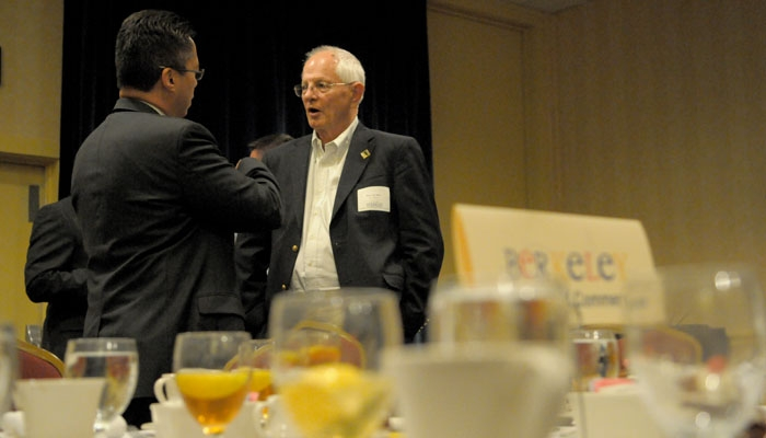 Photo: Mayor Tom Bates (right) speaks with Hotel Durant General Manager James Lim after presenting his seventh State of the City address.