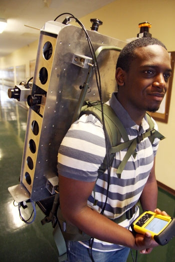 Photo: Graduate student Mason Smith sports a backpack made by UC Berkeley researchers that is equipped with scanners and cameras and can create 3D maps of building interiors.