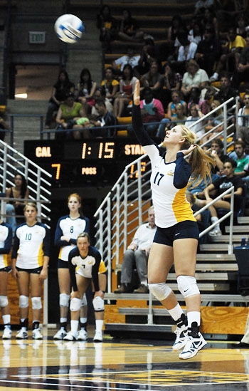 Photo: Sophomore defensive specialist Robin Rostratter, seen here serving, leads the Bears in service aces with 10. She also leads the team with 72 digs in 24 sets played.